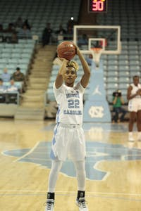 Senior guard Paris Kea (22) makes a basket during Wednesday's game against Virginia Commonwealth University at Carmichael Arena. UNC won 59-47.