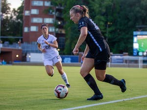 UNC sophomore forward/midfielder Avery Patterson (15) dribbles the ball at the soccer game against Washington on Thursday August 19, 2021 at the Dorrance Field.