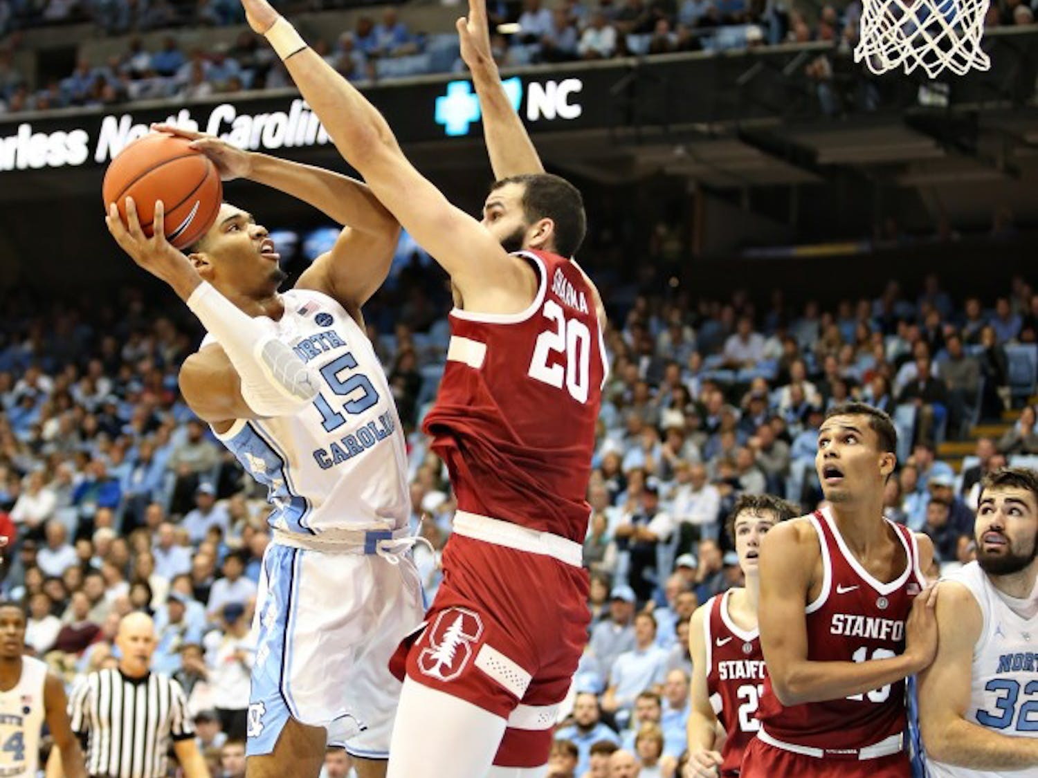 UNC forward Garrison Brooks (15) pulls up to shoot while being guarded by Stanford center Josh Sharma (20) in the Dean Smith Center on Monday, Nov. 12, 2018. UNC won 90-72 against Stanford.
