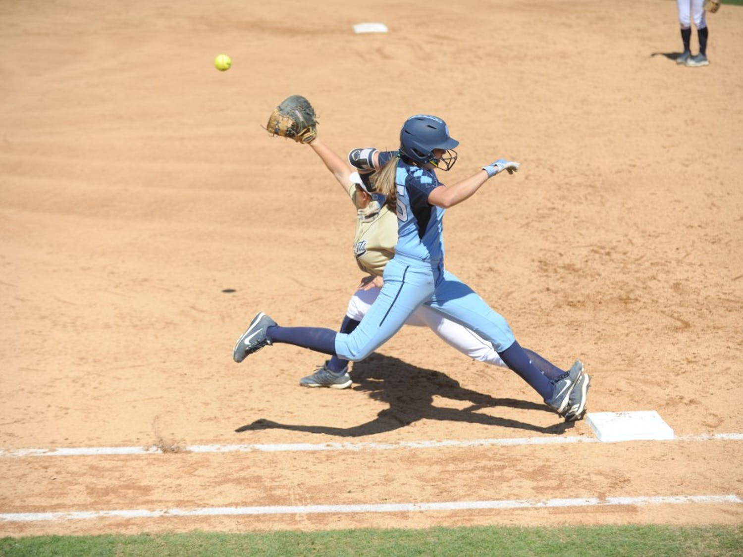 Megan Dray (55) reaches first base safely during UNC's Softball game vs. Georgia Tech on Sunday, Mar. 24. UNC lost the game 3-2.