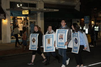 (left to right) Alexis Byrd, Annabeth Poe, Tyler Brown, and Jessica Hardison strolled down Franklin St. as UNC's National Championship banners.
