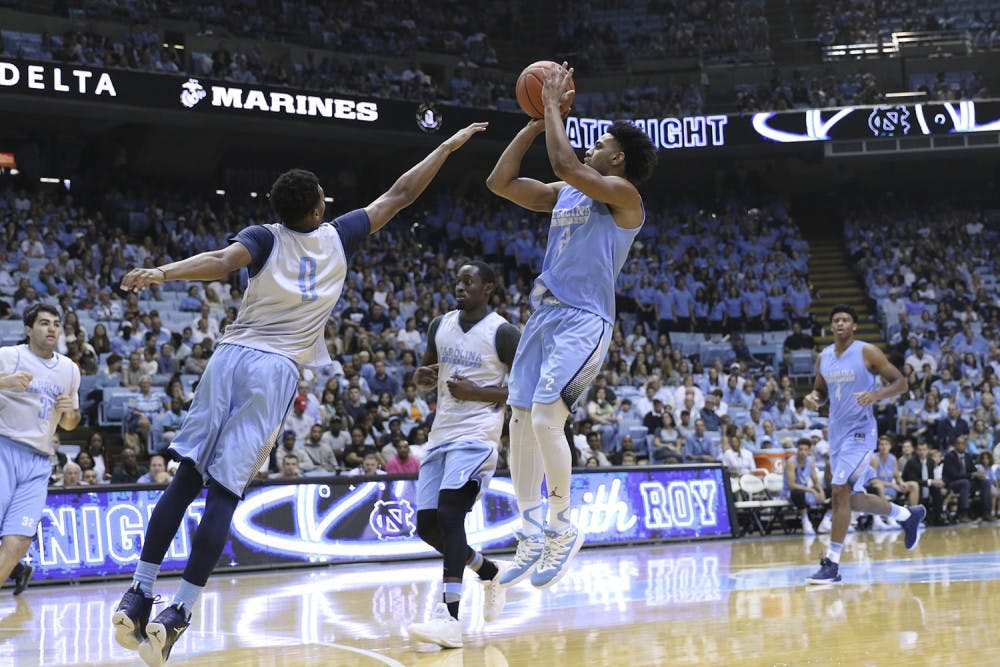 <p>UNC guard Joel Berry (2) pulls up for a 3-point shot over guard Nate Britt (0) during the Late Night with Roy scrimmage.</p>