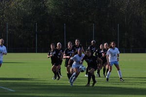 Forward Zoe Redei (15) chases down a ball after a North Carolina corner kick in Saturday's game against High Point at WakeMed Soccer Park in Cary.