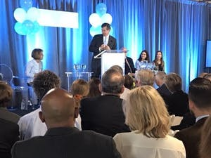 North Carolina GovernorRoy Cooper speaks at the opening for the Horizons Center, which helps pregnant or parenting moms with substance abuse problems.