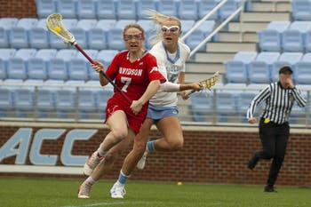UNC women's junior midfielder Scottie Rose Growney (15), chases her Davidson opponent at Dorrance Field on Sunday, Feb. 16, 2020. UNC were leading 15-1 by halftime and defeated Davidson with a final score of 22-5.