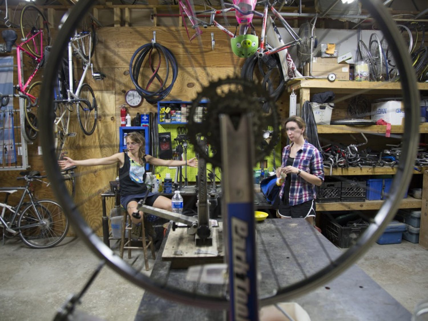"""Jolie Day (left) and Victoria Petermann talk with Giorgi before Moon Cycles on Sept. 7, 2015. """"""""I meet the coolest people,"""" Day said.  """"Bikes are art."""""""