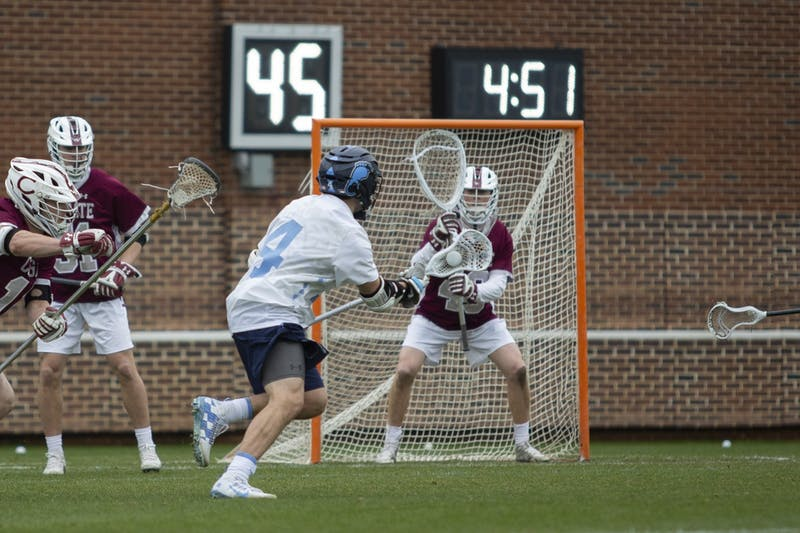 UNC junior attackman Chris Gray (4) scored four points in the first quarter against Colgate at Dorrance Field on Sunday, Feb. 1, 2020. UNC won 19-6.