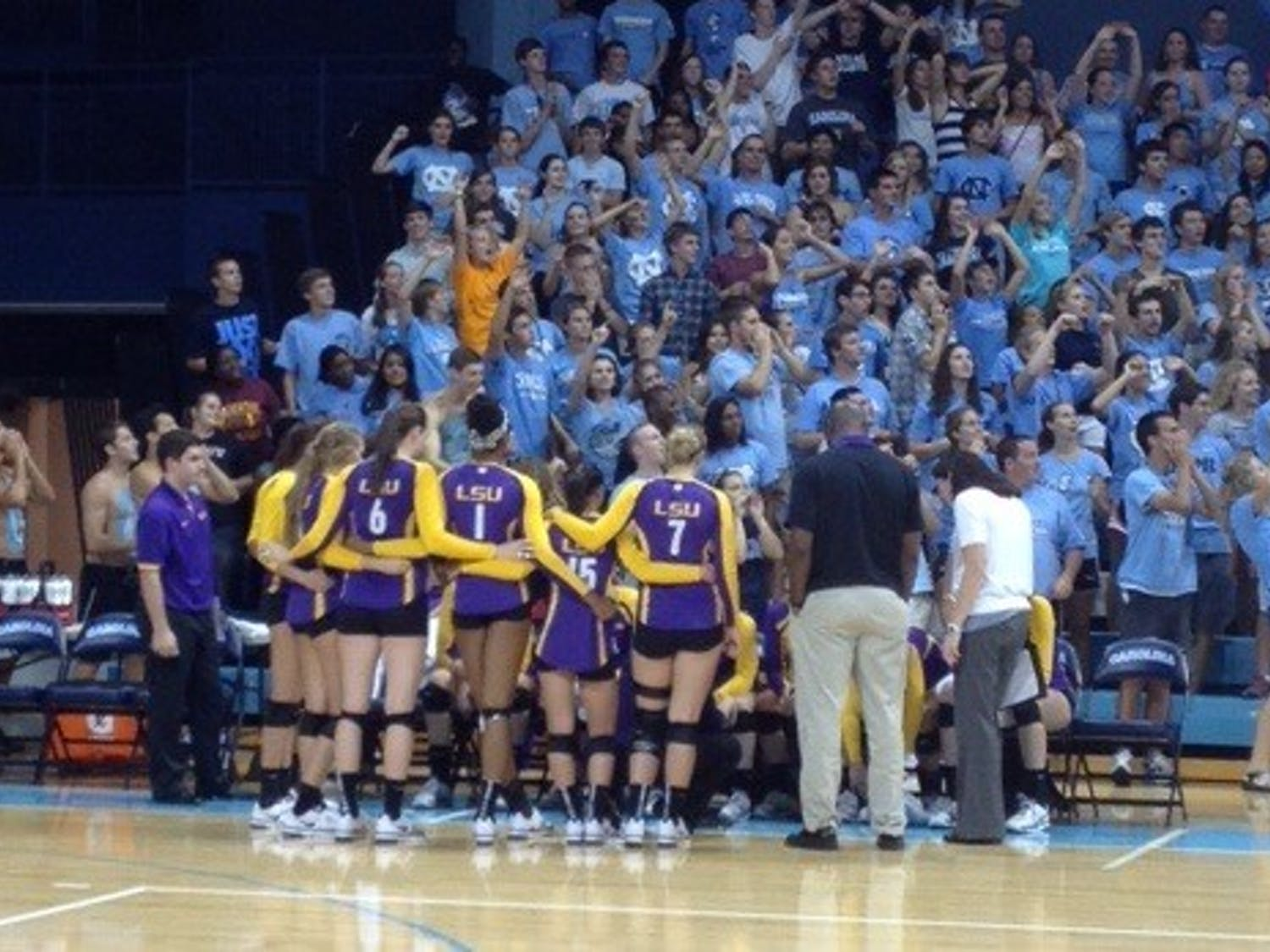 LSU players huddle around the bench during Friday's volleyball game at Carmichael Arena.