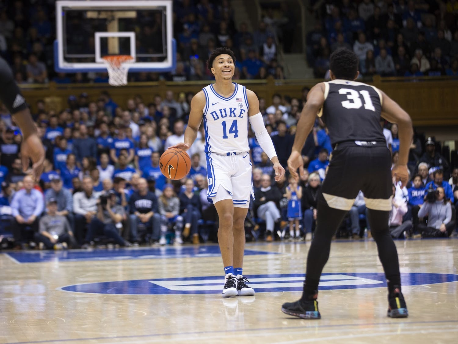 Duke's junior guard Jordan Goldwire (14) dribbles the ball during the game against Wofford in Cameron Indoor Stadium on Thursday, Dec. 19, 2019. Duke beat Wofford 86-57. Photo by Charles York, courtesy of The Chronicle.