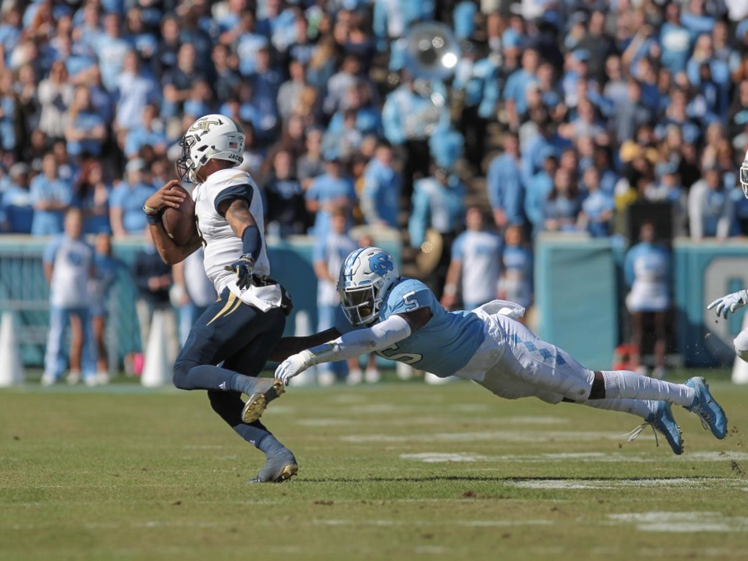 Cornerback Patrice Rene (5) dives for a tackle during the game against Georgia Tech Saturday, Nov. 3, 2018 at Kenan Memorial Stadium.. UNC lost to Georgia Tech 38-28.