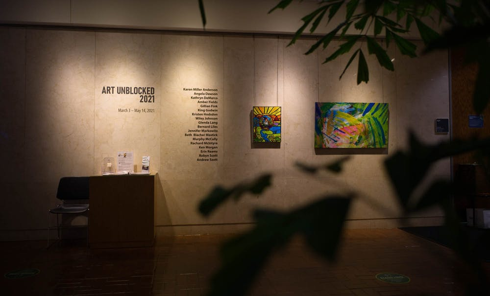Pieces from the Art Unblocked 2021 exhibition hang on the walls of the Block Gallery in the Raleigh Municipal Building on Wednesday, Mar. 17, 2021. The exhibition feautures works of art created by emerging and established artists with disabilities.