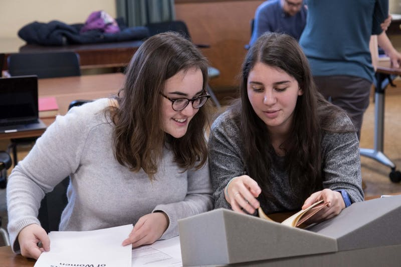 "Blythe Gulley and Caroline Alessandro are in UNC Professor Jeanne Moskal's English class that will present ""Reconstructing Frankenstein's Monster: Mary Shelley's World in Print"" on Thursday in Wilson Library. Photo by Aleah Howell."