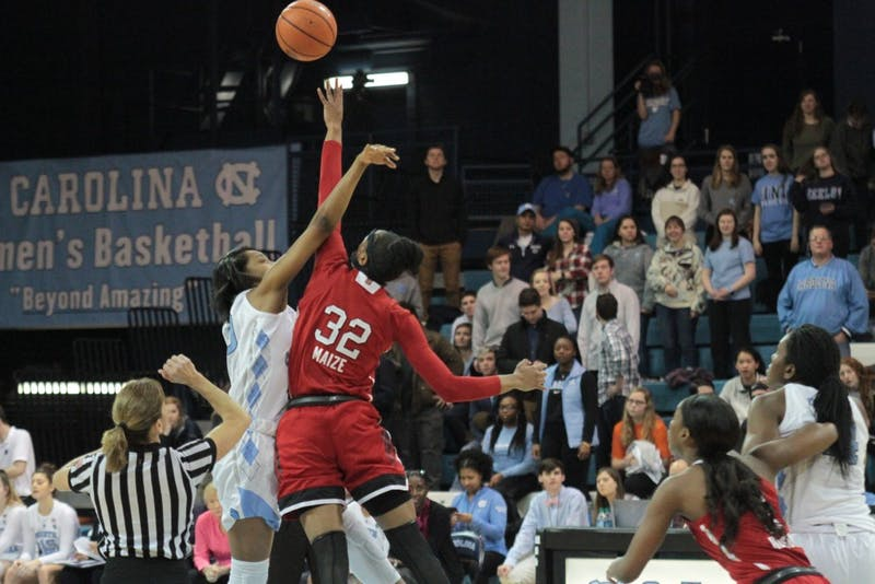 Forward Jaelynn Murray (30) jumps for the tipoff against N.C. State on Jan. 18 in Carmichael Arena.
