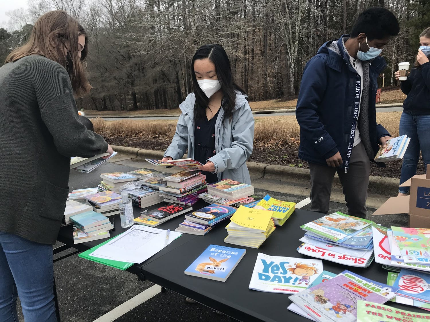 UNC's Future Business Leaders of America club holds a book drive for local elementary students outside of Chapel Hill Public Library on Saturday, Feb. 27, 2021.
