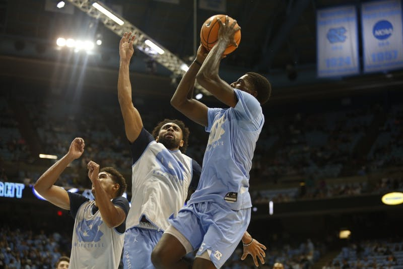 Guard Jalek Felton (5) shoots over teammate Joel Berry II (2) during UNC's Late Night With Roy scrimmage on Oct. 13.