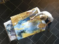 SeniorArt Developer, Hannah Stewart, works in theKalisher studio in Carrboroto create a piece of healing art. Photo Courtesy of David Winton.