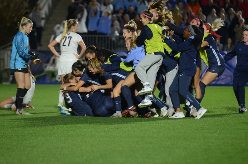 The UNC women's soccer team celebrates with a dog pile after defeating Georgetown in the 108th minute, 1-0, in the College Cup semifinals on Nov. 30, 2018 at Sahlen's Stadium at WakeMed Soccer Park in Cary.