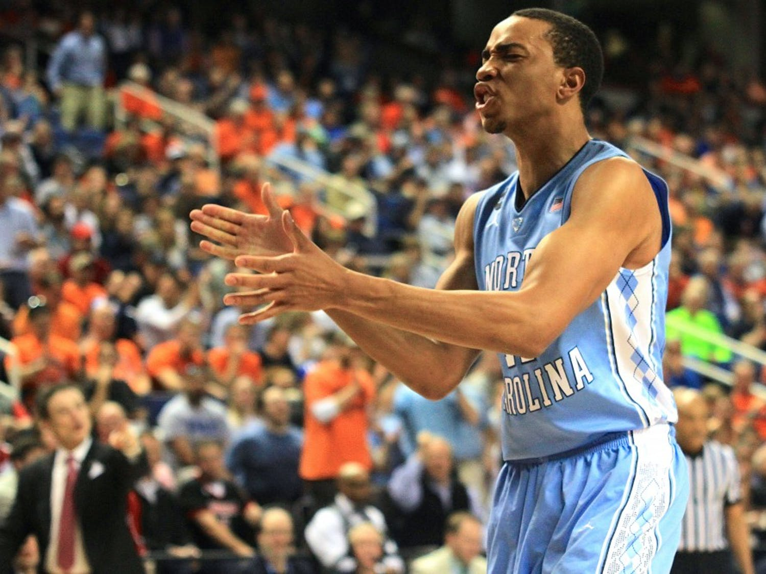 Brice Johnson celebrates a dunk during the first half. Johnson led the Tar Heels in points and rebounds in Thursday's game against Louisville.