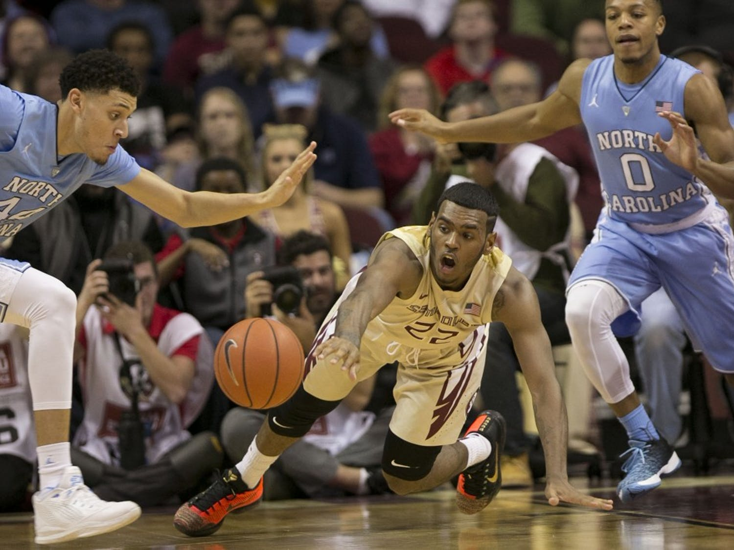 Florida State's Xavier Rathan-Mayes (22) loses control of the ball under pressure from North Carolina's Justin Jackson (44) and Nate Britt (0) during the second half on Monday, Jan. 4, 2016, at the Tucker Center in Tallahassee, Fla. (Robert Willett/Raleigh News & Observer/TNS)