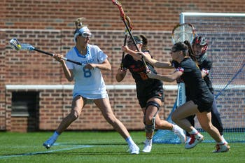 UNC senior attacker Katie Hoeg (8) searches for a pass during the game against Maryland at Dorrance Field on Saturday, Feb. 22, 2020. No 1. UNC won against No 4. Maryland 19-6.