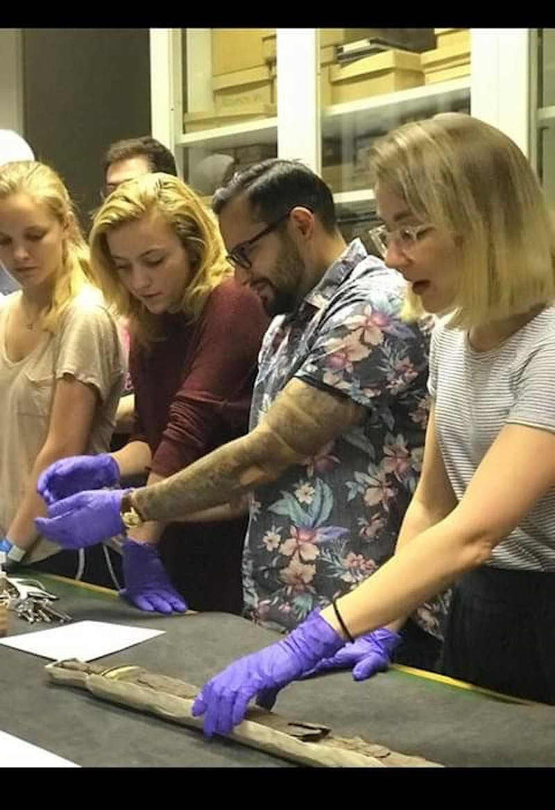 (From left to right) Allie Dailey, Becca Broughton, Edward Yanez, and Dr. Sue Brunning handle Anglo-Saxon artifacts dating earlier than 1066 A.D.at British Museum in London led by Brunning, the curator for the Early European Medieval Collections at the British Museum. Photo courtesy of Trum deVries.