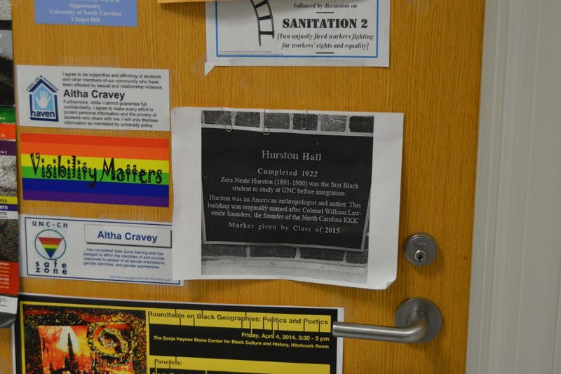 "A sign outside of Professor Altha Cravey's office displays a sign for ""Hurston Hall."""
