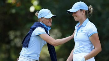 Junior golfer Kelly Whaley (right) jokes with associate head coach Aimee Neff during the Briar's Creek Invitational in March. Photo courtesy of UNC Athletic Department.