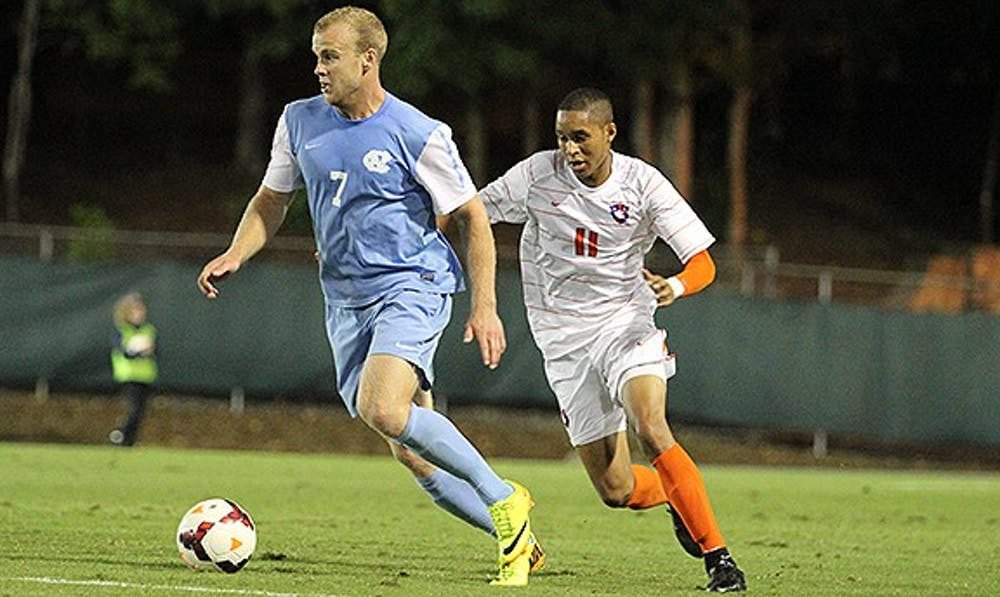 Men's soccer captures first conference win