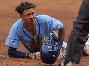 UNC sophomore outfielder Justice Thompson (20) slides onto third base at the game against Louisville on Sunday May 16th, 2021 at Boshamer Stadium in Chapel Hill. The Tar Heels won 10-5.