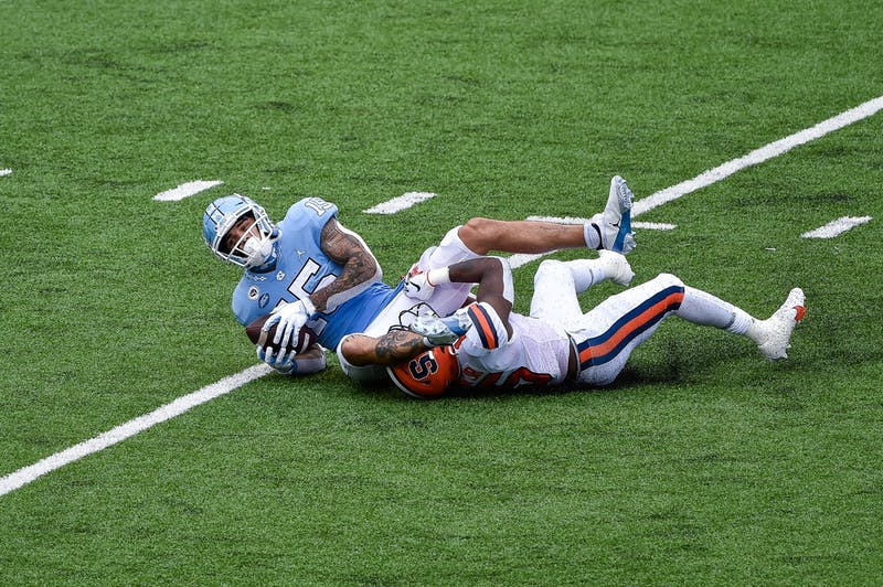 UNC senior wide receiver Beau Corrales (15) catches the ball during a game against Syracuse in Kenan Memorial Stadium on Saturday, Sept. 12, 2020. UNC beat Syracuse 31-6.