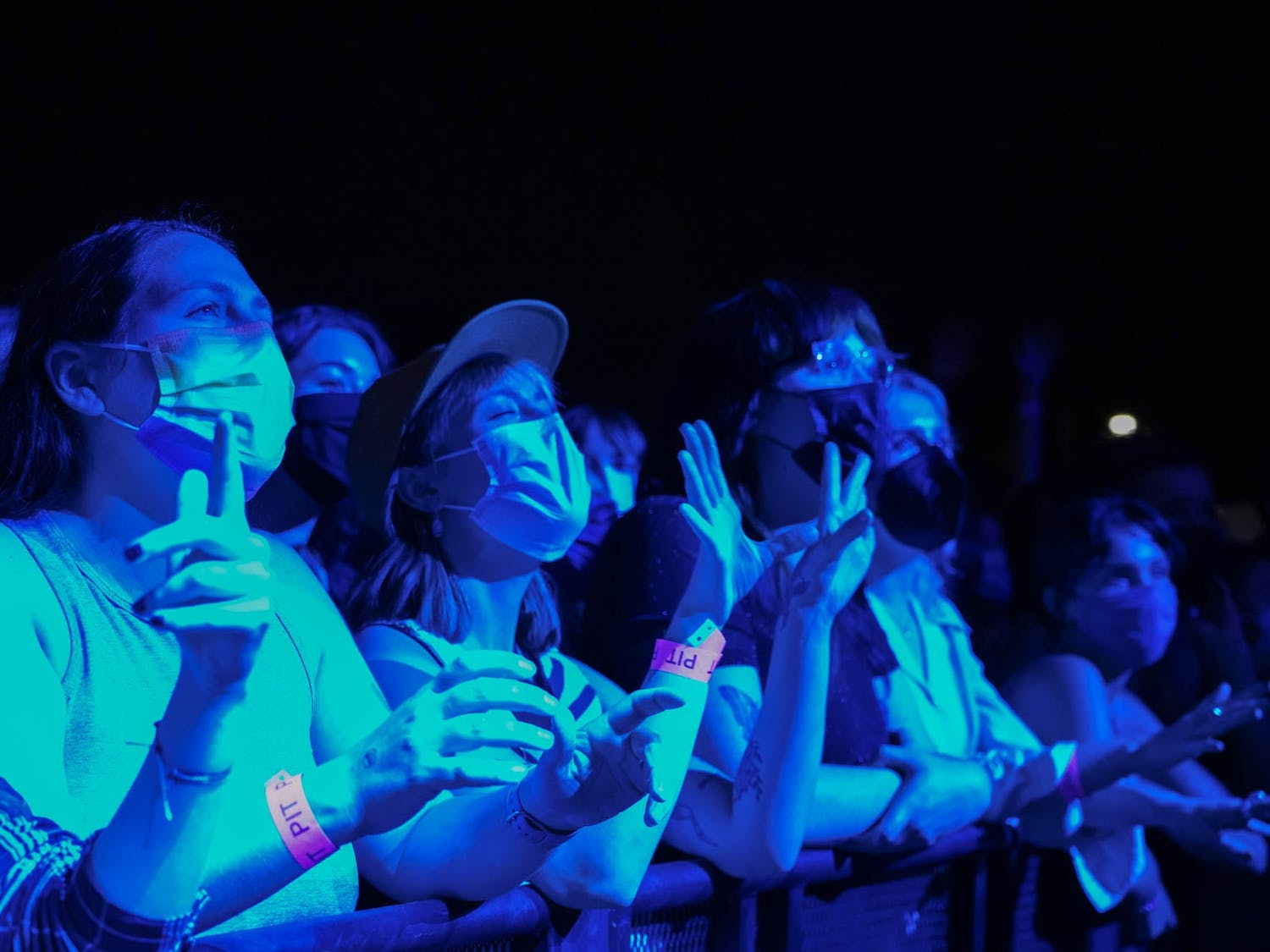 Grace Paton, Kerry Lott, and Erica Essigman watch the Phoebe Bridgers show at the Red Hat Ampitheater in Raleigh, NC, on Sept. 21, 2021.