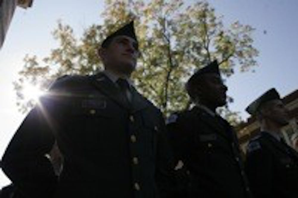 <p>UNC ROTC Army cadets stand at ease waiting for the annual UNC Veterans Day Ceremony to begin in 2012. &nbsp;The ceremony, which usually takes place at Gerrard Hall, was held at the Carolina Alumni Memorial in Memory of Those Lost in Military Service between Phillips and Memorial halls.</p>