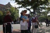 Members of the Raging Grannies, a local activist group, made an appearance at an NAACP rally in front of the old post office on Franklin St. Wednesday afternoon.