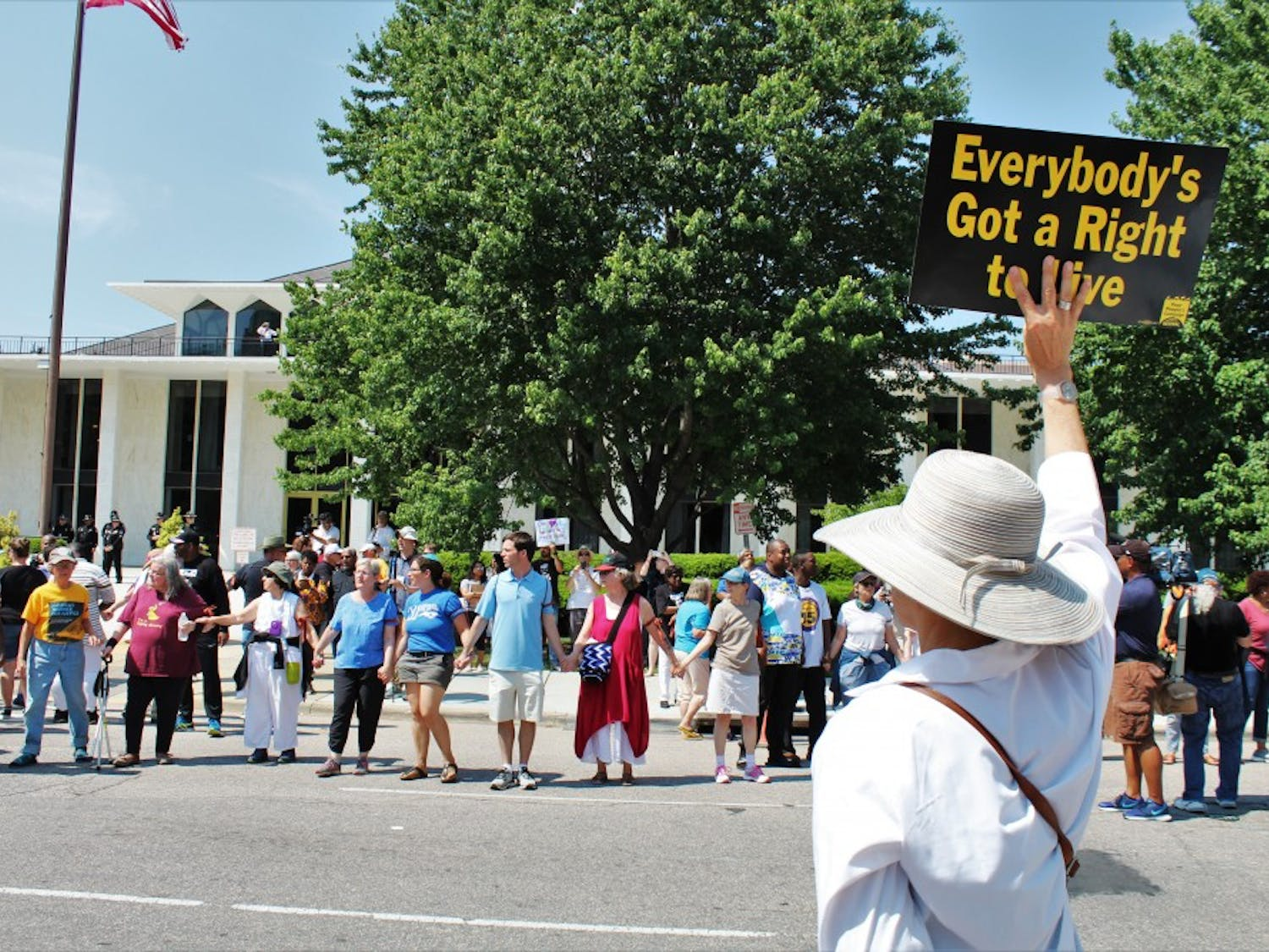 """A protestor holds a sign stating """"Everybody's Got a Right To Live"""" during the May 14 rally in Raleigh."""