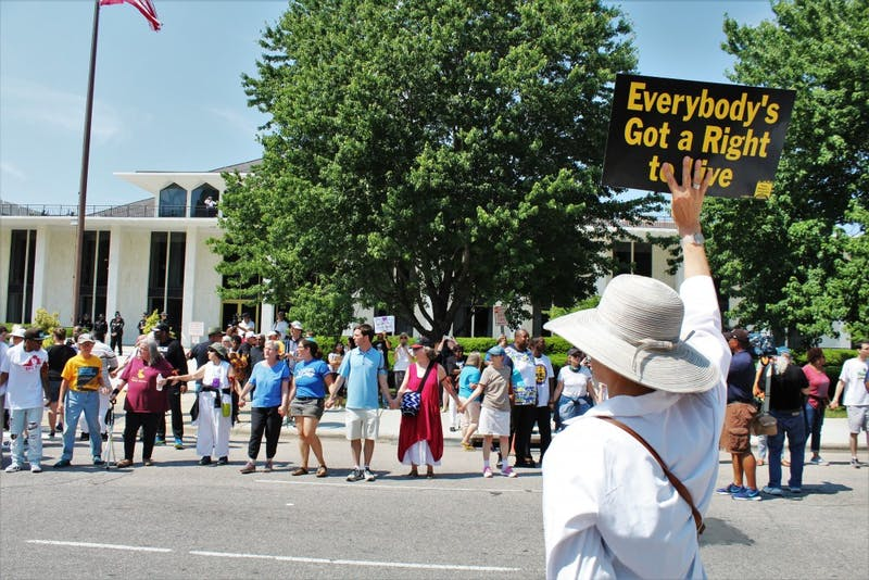 "A protestor holds a sign stating ""Everybody's Got a Right To Live"" during the May 14 rally in Raleigh."