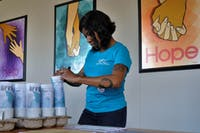 Laing, Orange County Rape Crisis Center's Business and Finance Manager, gets prizes ready for guests at the OCRCC's Housewarming and 45th Birthday Kickoff event on Friday, March 22, 2019. OCRCC's new office is located at 1506 E. Franklin St. #200, Chapel Hill, NC 27514.