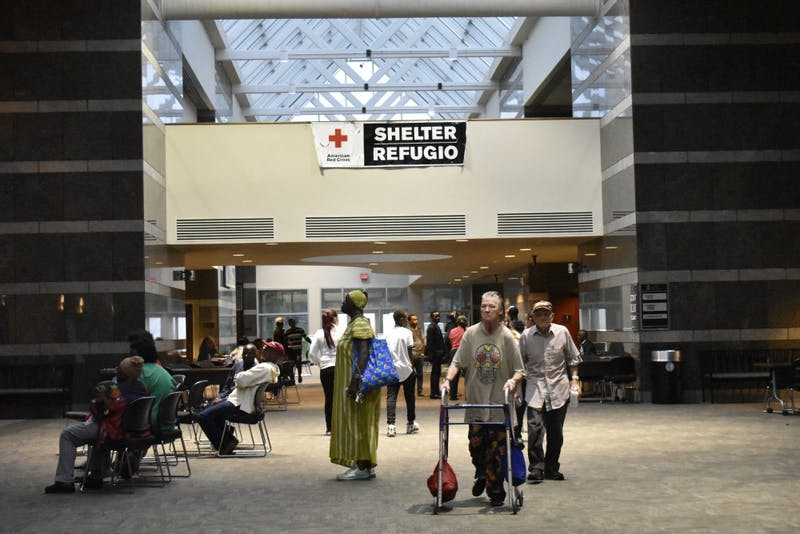 Many seek refuge from Florance's rain at the Friday Center Shelter on Sunday, Sept. 16.