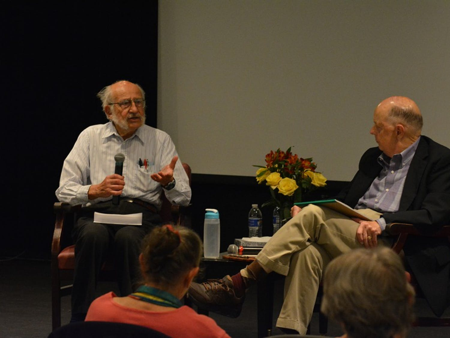 Tom Wolf (left) talks to Bill Crittenden about having conversations about death and dying at the Seymour Center on Thursday night.