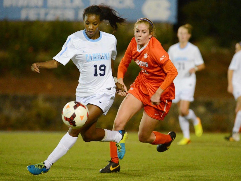 UNC midfielder Crystal Dunn (19) runs down a loose ball.