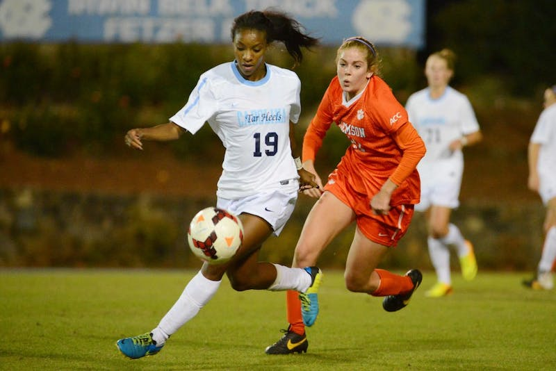 UNC midfielder Crystal Dunn (19) runs down a loose ball.