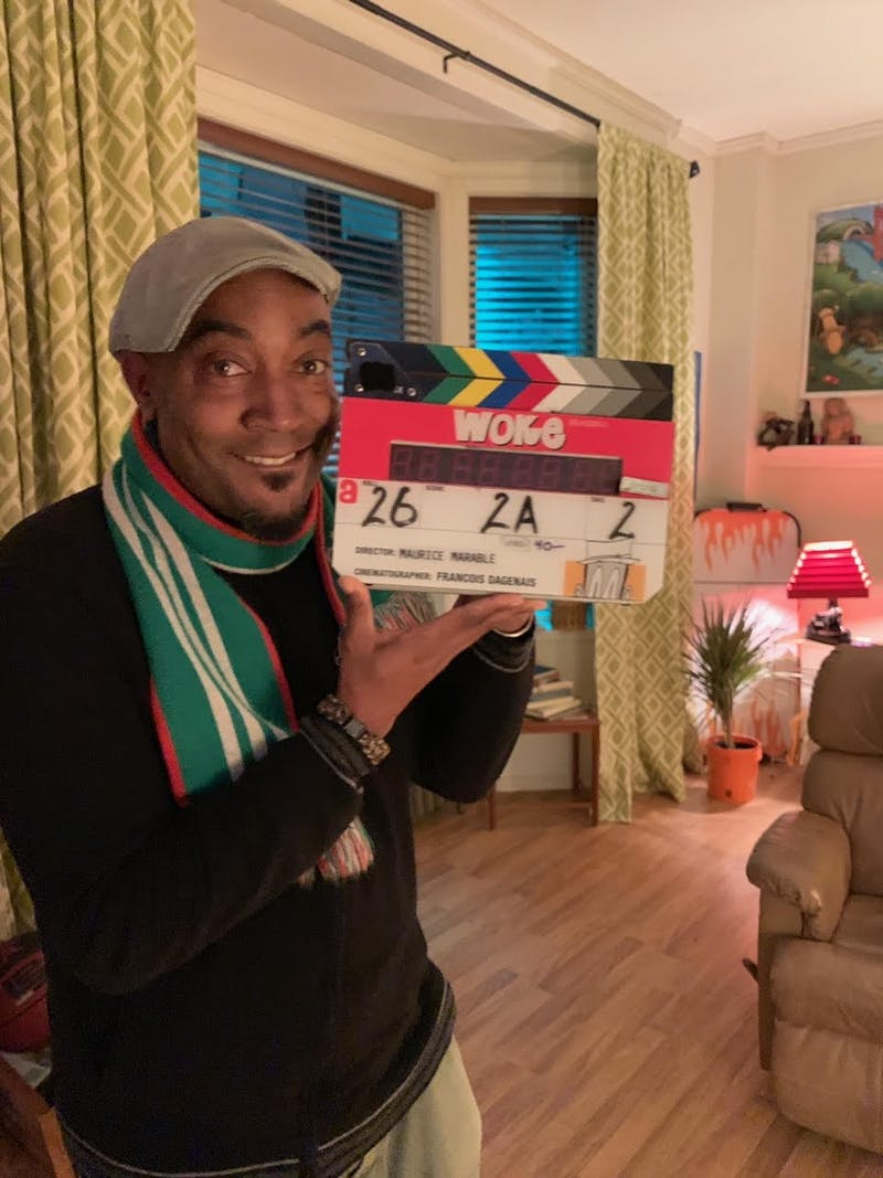"Keith Knight smiles on the set of the Hulu original series ""Woke,"". Photo courtesy of Keith Knight."