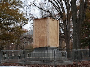 A wooden box surrounds the pedestal where Silent Sam stood on Monday, Dec. 3, 2018.