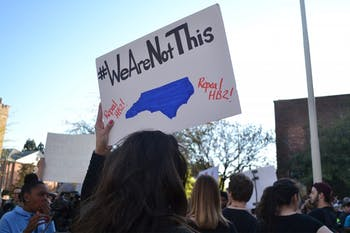 """Hundreds gathered to protest North Carolina's recent passing of House Bill 2 which has been called """"anti-lgbt""""Protesters against House Bill 2 gather in front of the Chapel Hill Post Office."""