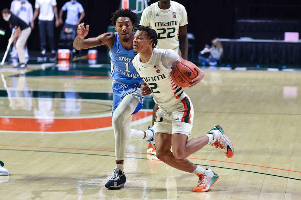 UNC's junior forward Leaky Black (1) attempts to guard Miami's sophomore guard Isaiah Wong (2) during a game on Tuesday, Jan. 5, 2021. UNC beat Miami 67-65. Photo courtesy of Maggie Bolton and Jeffrey Ridley.