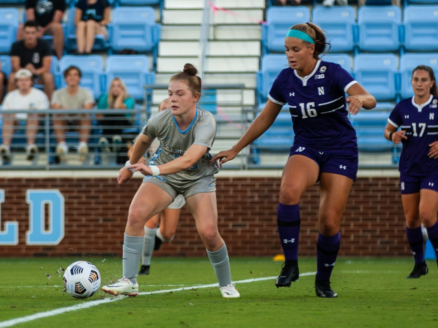 Freshman forward Emily Murphy (35) moves the ball past the defense at the home game against Northwestern on Sept 2. UNC won 2-0.