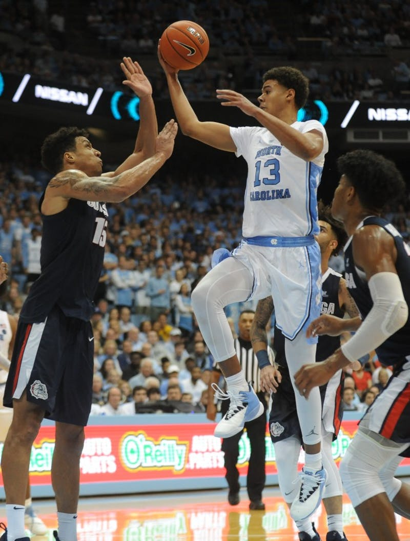 UNC grad student and guard Cameron Johnson (13) goes up for a layup  during Saturday's win against Gonzaga. UNC won 32 to 103-90.