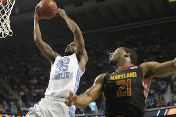 Reggie Bullock goes for an open layup while Maryland's Pe'Shon Howard watches.