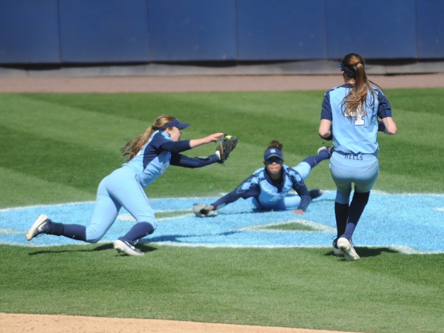 Infielder Abby Settlemyre (29) makes a diving catch during UNC's Softball game vs. Georgia Tech on Sunday, Mar. 24. UNC lost the game 3-2.