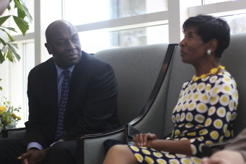 Former UNC men's basketball playerPhil Ford listens as Esther Jones, a former schoolteacher who is pledging $1.4 million to his newly-formed professorship, talks to reporters.