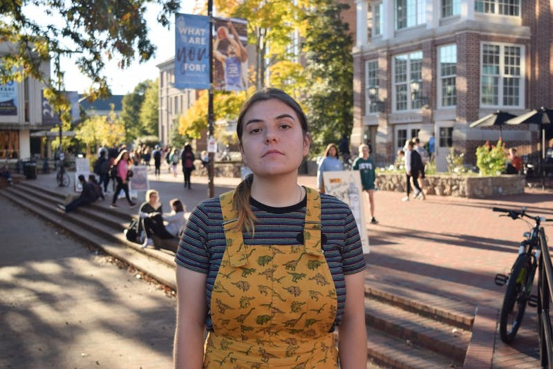 "Iris Maxfield, a junior political science major, is one of the many international students who could be impacted by Trump's Immigration Services policy. ""I don't think it's going to pressure people a lot — I think it's more symbolic,"" she said. ""I think it's going to make it tougher because it shows symbolically that we're not welcome."""